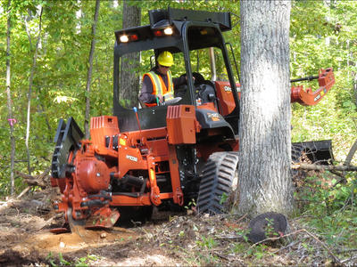 Figure 5: The vibratory plow in action, severing roots to prevent the spread of the oak wilt pathogen between root systems. Photo credit Bill Cook.