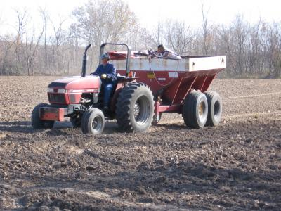 Modified fertilizer spreader with tree seed