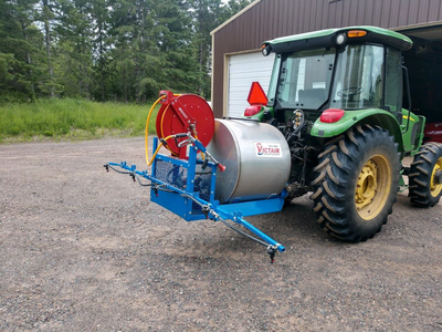 Figure 5: Tractor sprayer with 150 gallon tank, P.T.O. driven. Boom is 12 feet with 5 nozzles and when fully raised can cover about 20 feet.